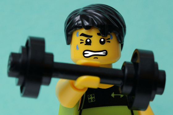 Image of lego character lifting weights, to signify power